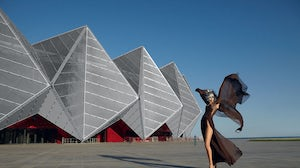 Model wearing Tilmann Grawe in front of Crystal Hall, Baku | Photo: Jacques Beneich