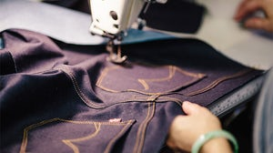 Stitching together a pair of Levi's jeans | Source: Levi's
