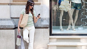 A woman using her smartphone while shopping | Source: Shutterstock