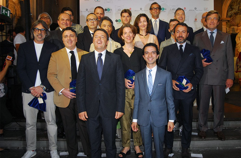 Prime Minister Matteo Renzi, Imran Amed and representatives from 30 leading menswear retailers | Source: BoF