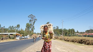 A woman in Addis Ababa carries wood to the market | Source: Shutterstock
