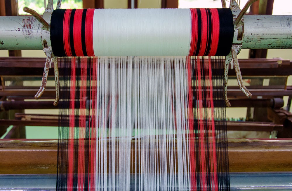 A loom with a pattern and wool yarn | Source: Shutterstock