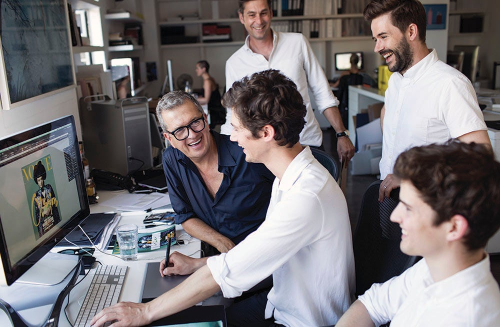 Mario Testino working with his team on the special issue of Vogue Japan | Source: Courtesy