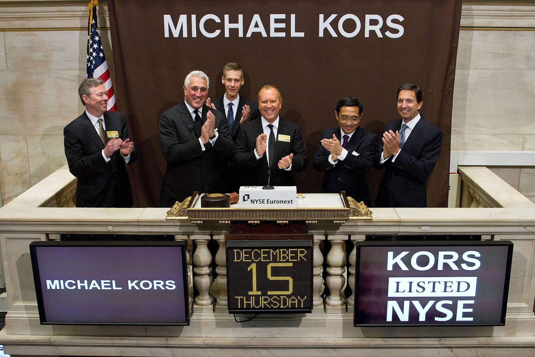 Michael Kors rings the opening bell at the New York Stock Exchange | Photo: Ben Hider/NYSE Euronext via Getty Images