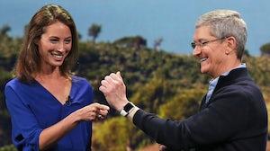 Model Christy Turlington Burns and Apple CEO Tim Cook | Source: Reuters