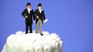 Same-sex wedding cake icing figures | Source: Shutterstock