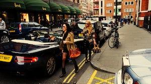 Two shoppers outside Harrods | Source: Chris JL