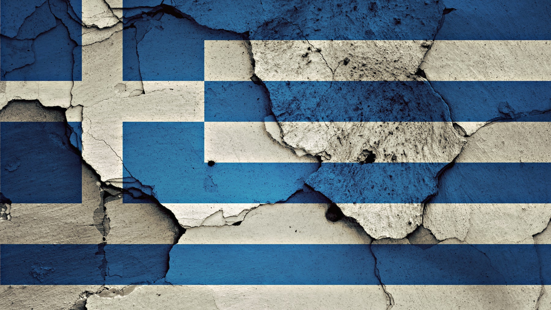 The Greek flag painted on a  wall | Source: Shutterstock