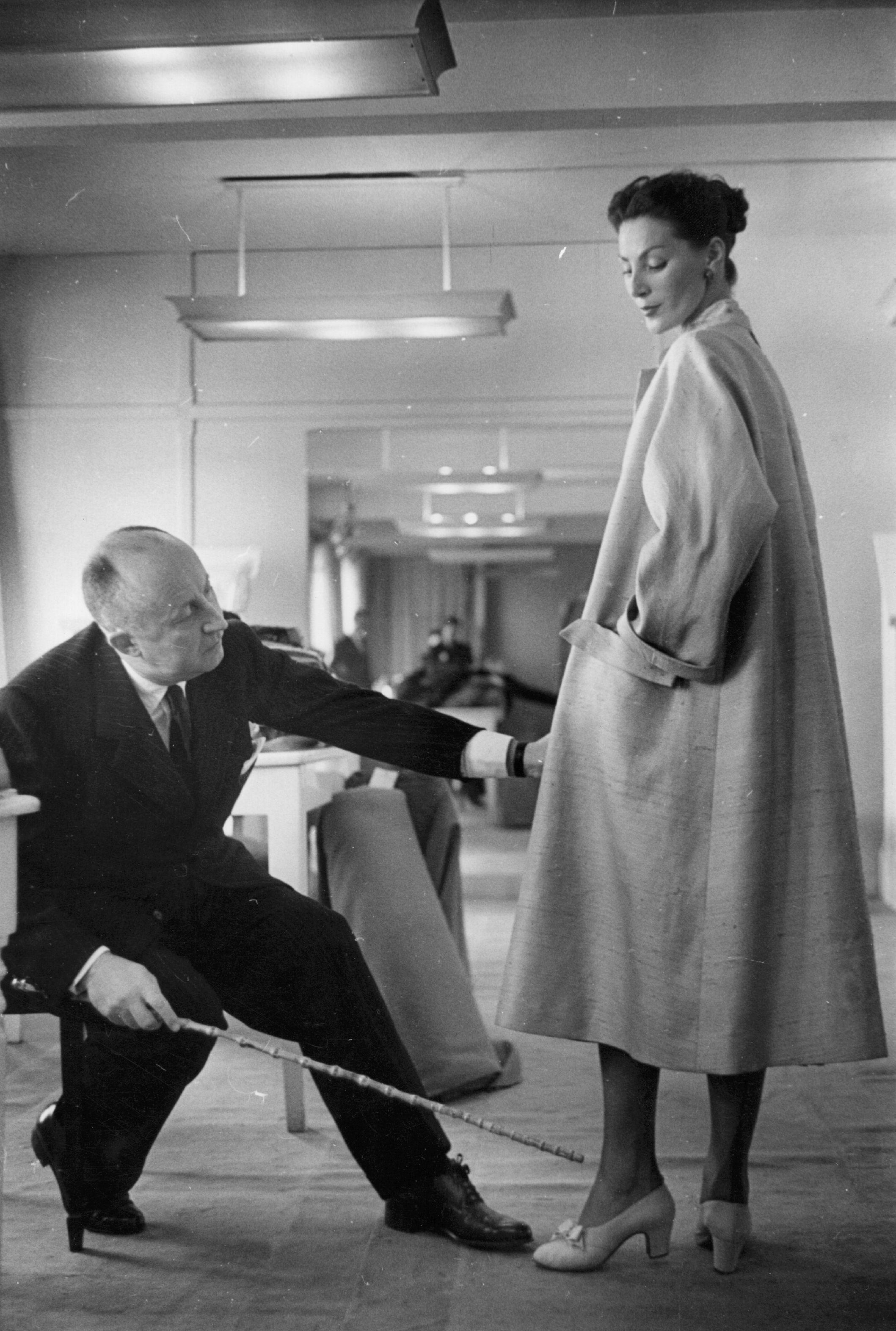 Christian Dior at work in his Paris studio  (1905-1957)   Source: Getty