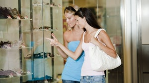 Teenagers shopping | Source: Shutterstock
