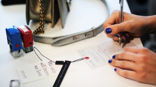 A Vestiaire Collective employee labels an item | Source: Vestiaire Collective