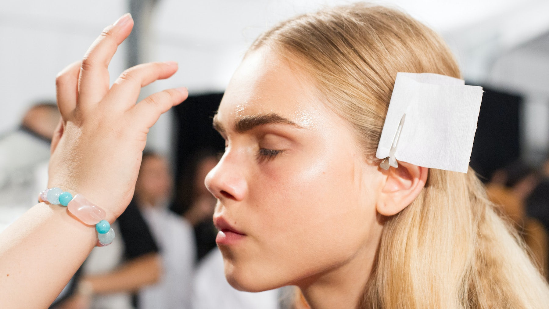 A model gets her makeup done for Givenchy Spring/Summer 2016 | Source: Indigital