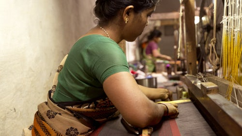 A weaver in India | Source: Shutterstock