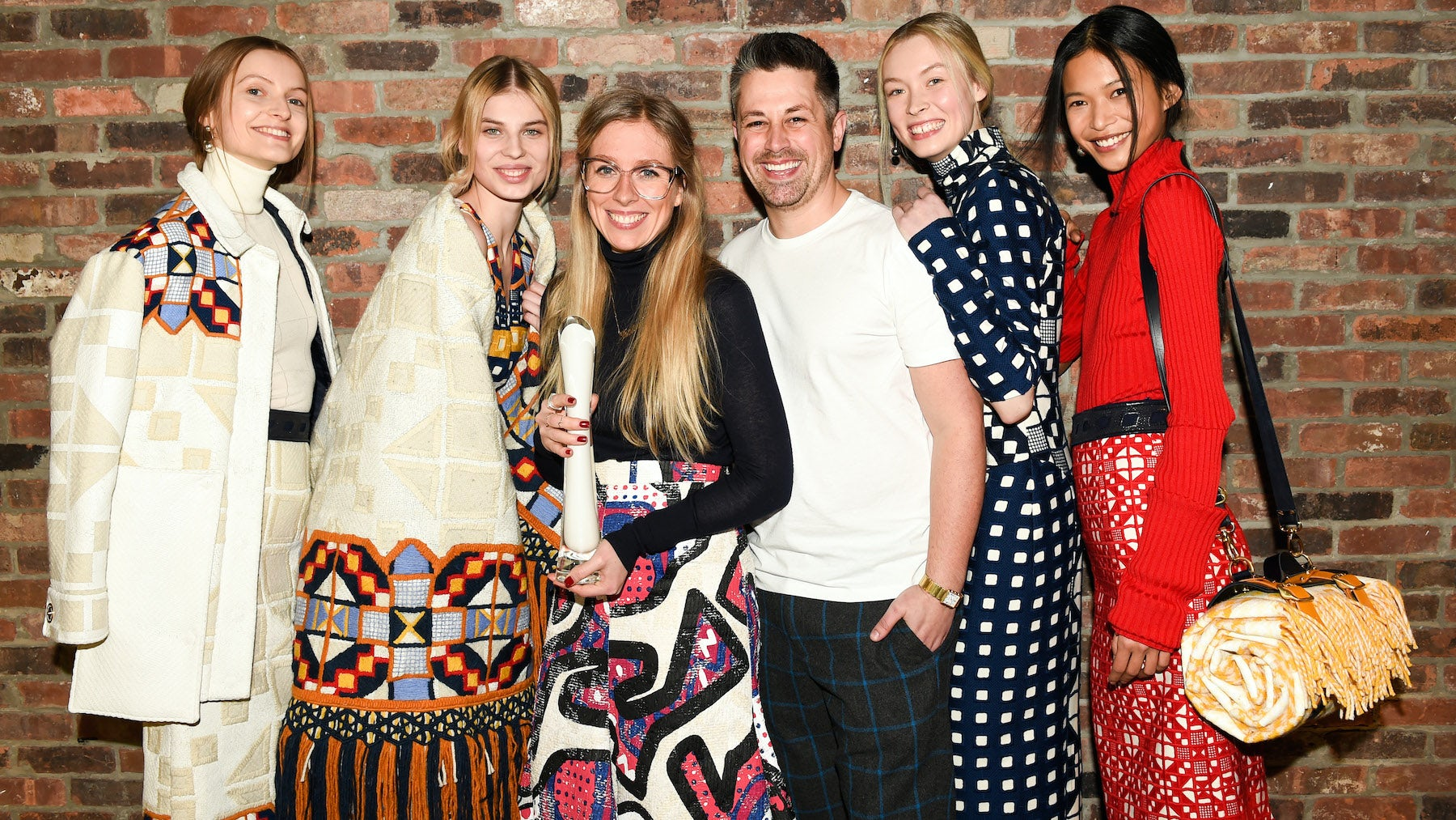 Catherine Teatum and Rob Jones with models wearing their designs   Source: Courtesy