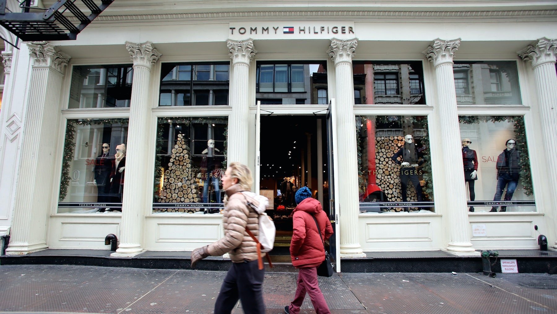 Shoppers outside a Tommy Hilfiger store | Source: Shutterstock