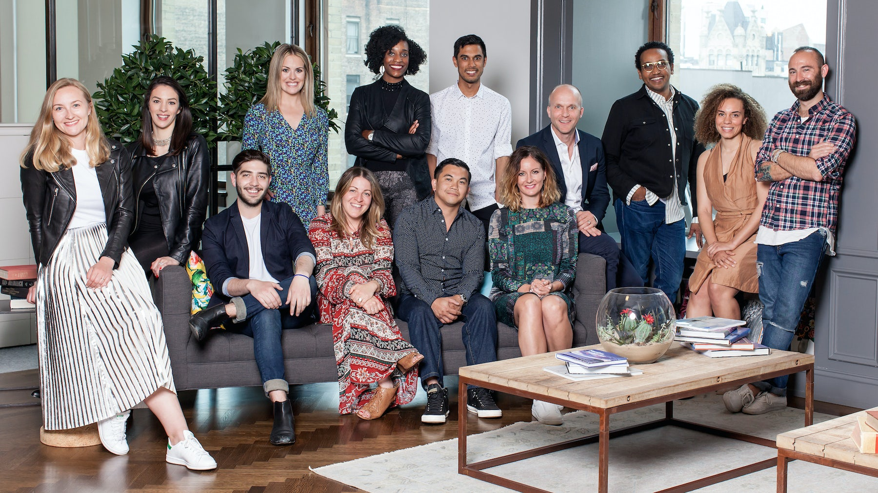 The H&M team, including Daniel Kulle, President of H&M N. America, seated on right chair arm | Source: H&M