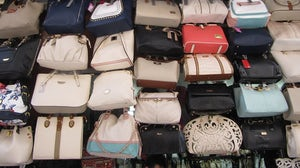 Handbags on sale at a market