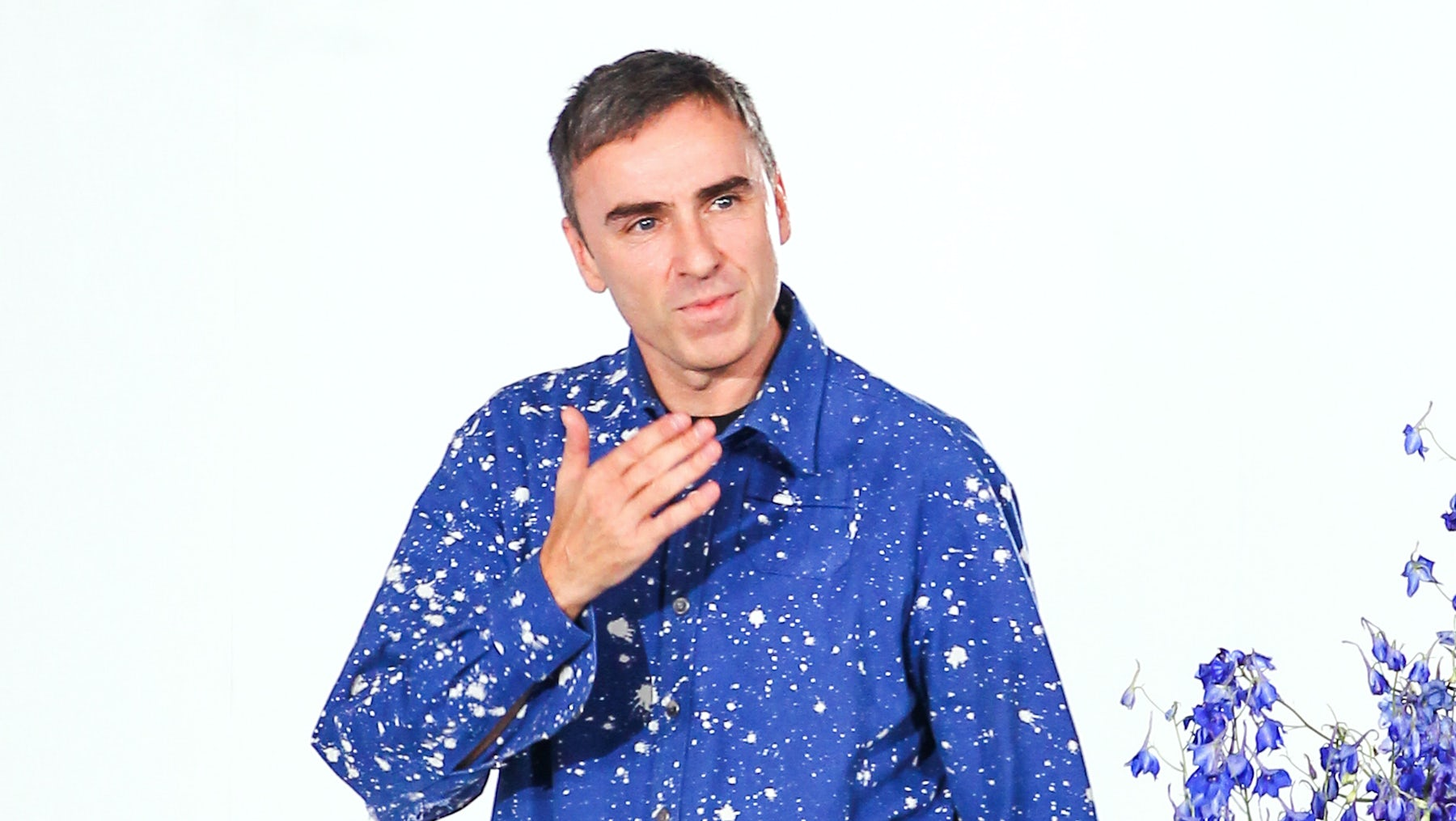 Raf Simons takes his final bow at Dior's Spring/Summer 2016 show | Source: Shutterstock