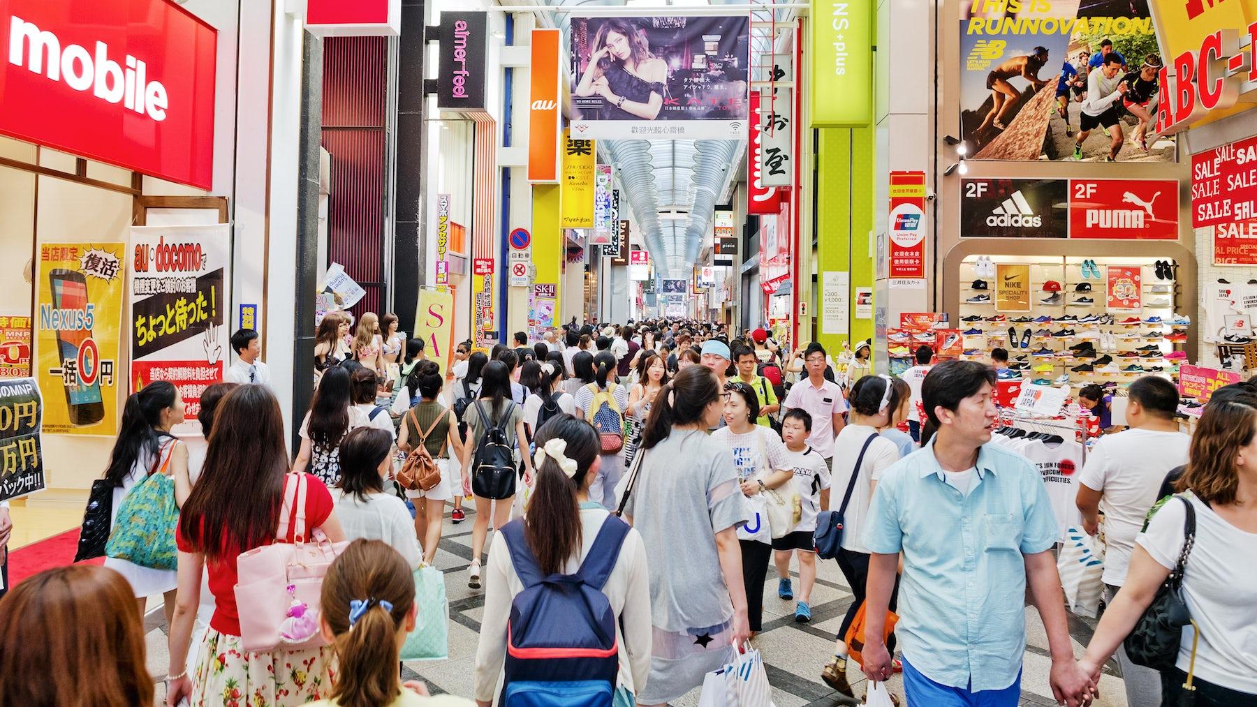 Shoppers in Dōtonbori, a tourist destination in Osaka, Japan | Source: Courtesy