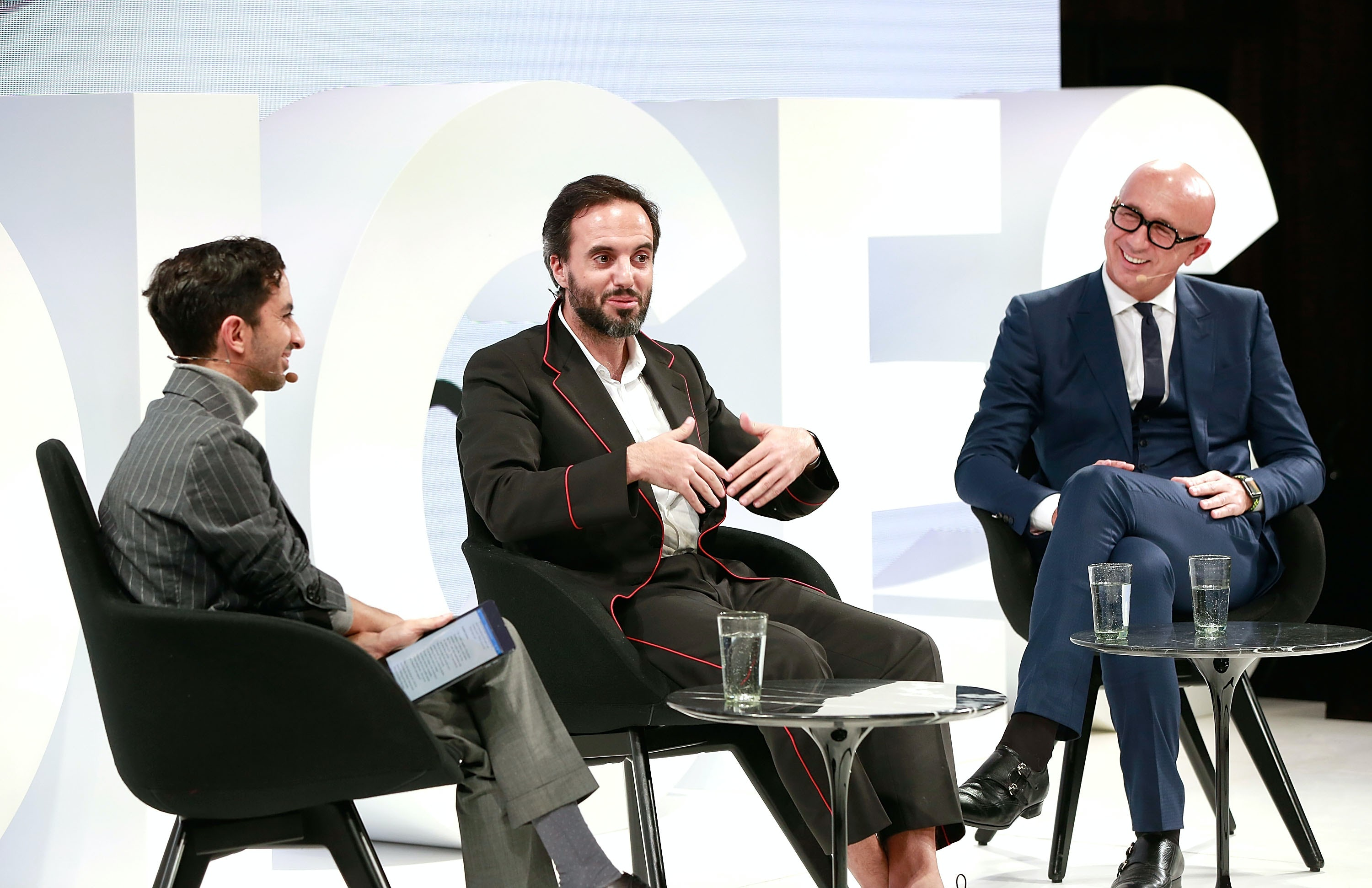 Imran Amed, José Neves and Marco Bizzarri on the VOICES stage | Source: Getty