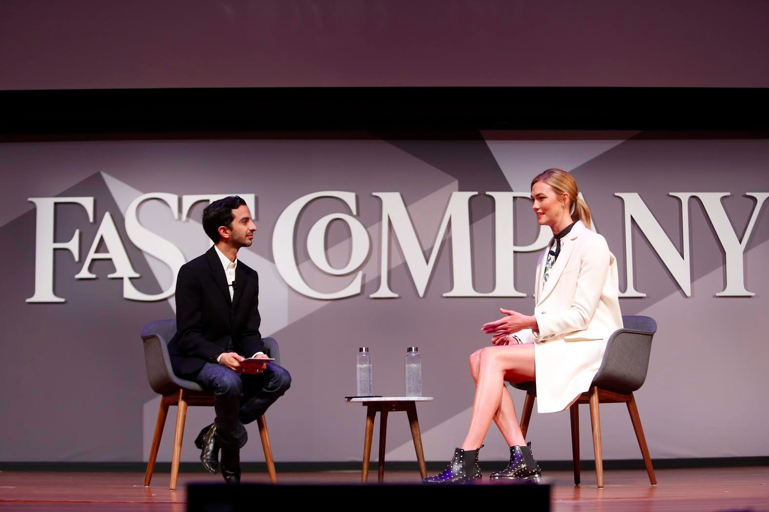 BoF's Imran Amed with Karlie Kloss on the Fast Company stage | Photo: Thos Robinson/Getty Images for Fast Company