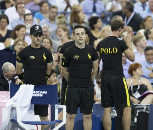 Ball boys wear Ralph Lauren's biometric shirts at the US Open 2014 | Source: Shutterstock