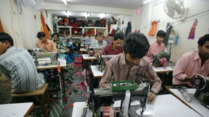 Textile workers in Indian factory | Source: Shutterstock