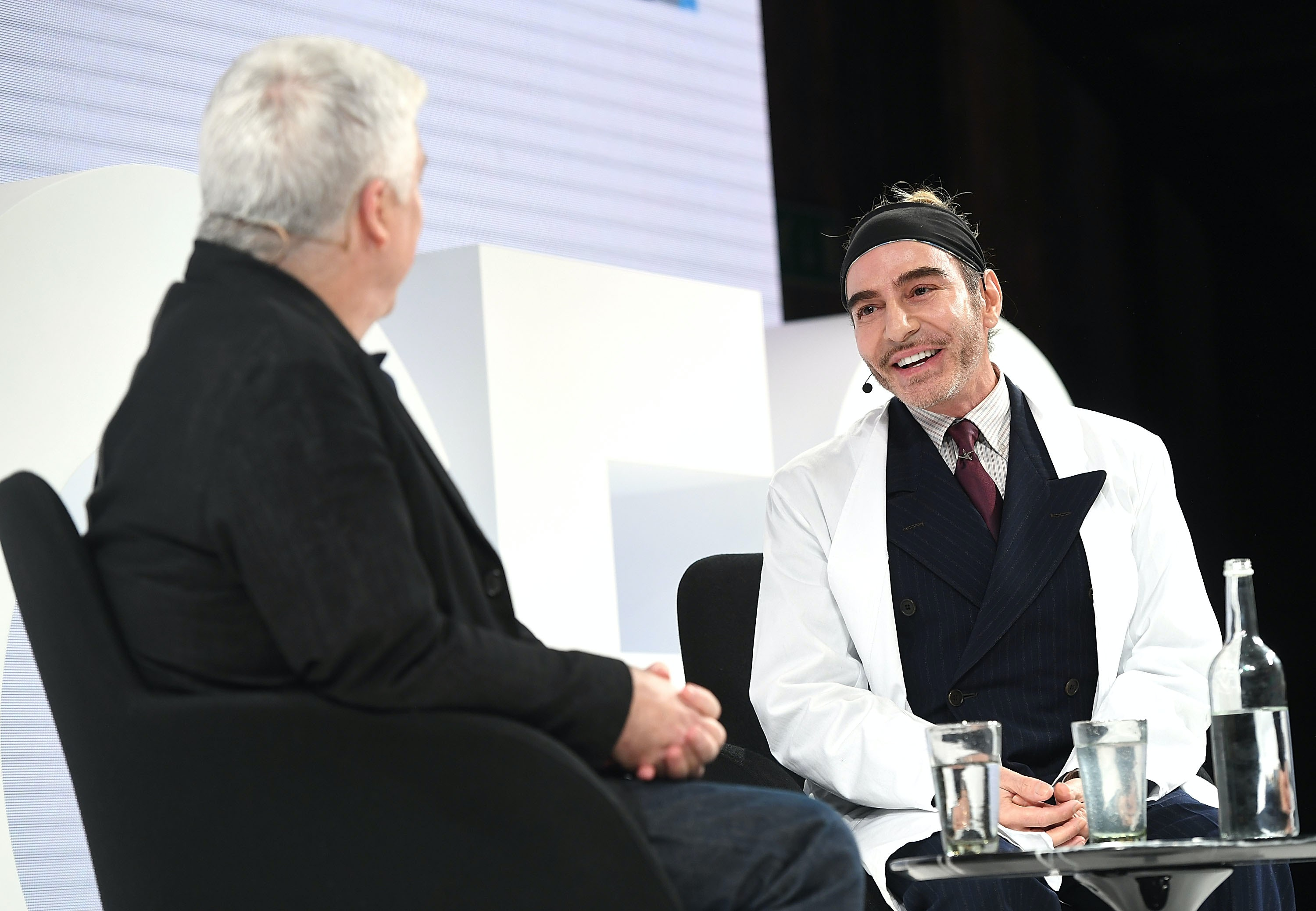 John Galliano in conversation with Tim Blanks on the VOICES stage in December 2016 | Source: Getty