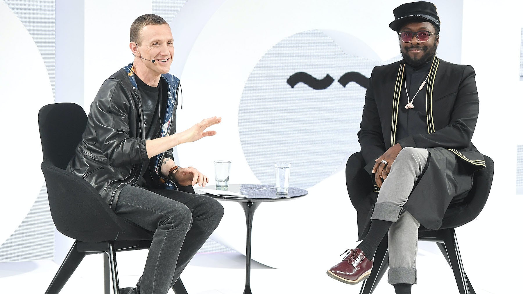 Ian Rogers and Will.i.am on stage at Voices | Source: BoF