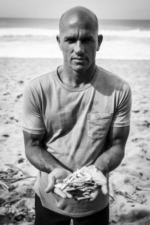 Kelly Slater in an Outerknown #itsnotok t-shirt | Source: Courtesy