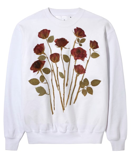 One of the machine-washable sweatshirts by Rottingdean azaar, featuring roses sealed by a heating technique | Source: Selfridges