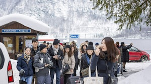 Group of Chinese tourists arriving at Hallstatt, Austria by boat | Source: Shutterstock
