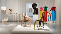 """Disobedient Bodies"" at The Hepworth Wakefield, featuring works by Sarah Lucas (centre), Hans Bellmer (on table) and J.W. Anderson (sweaters right and mannequin left) 