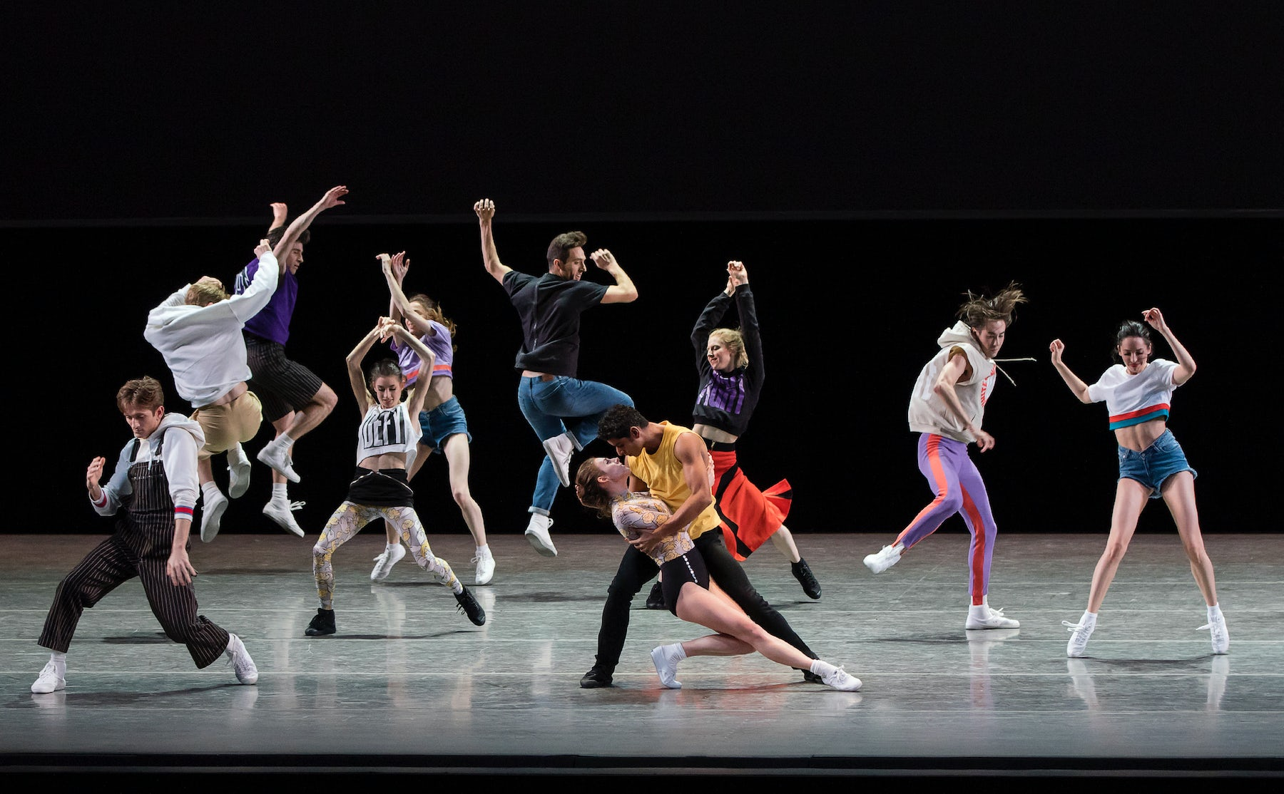 """NYCB Principal Dancers Tiler Peck and Amar Ramasar and the Company during the world premiere of """"The Times Are Racing,"""" costumed by Opening Ceremony   Photo: Paul Kolnik"""