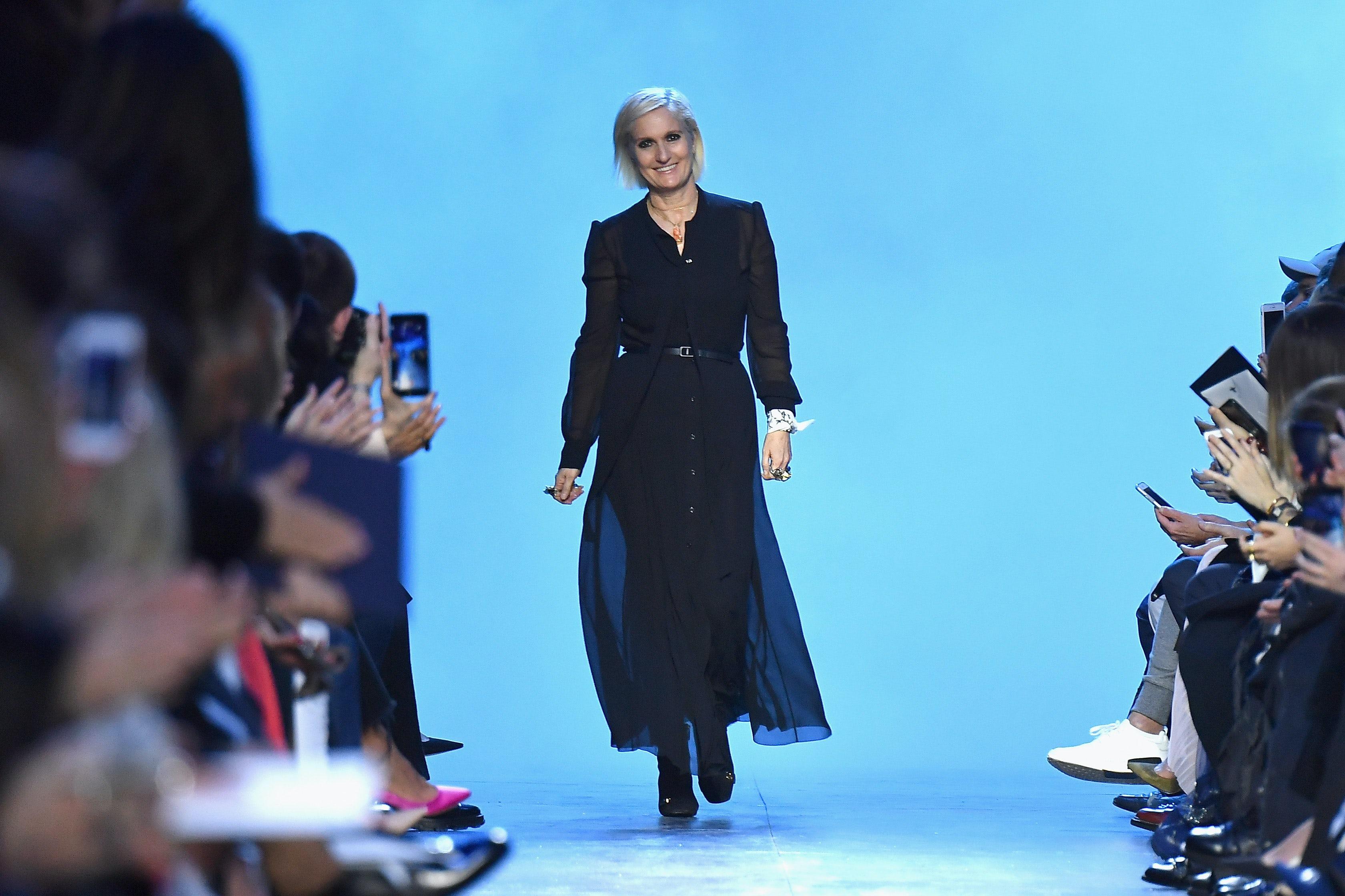 Christian Dior artistic director Maria Grazia Chiuri  at the label's Autumn/Winter 2017 ready-to-wear show | Getty