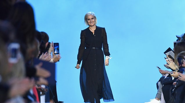 Christian Dior artistic director Maria Grazia Chiuri  at the label's Autumn/Winter 2017 ready-to-wear show | Getty