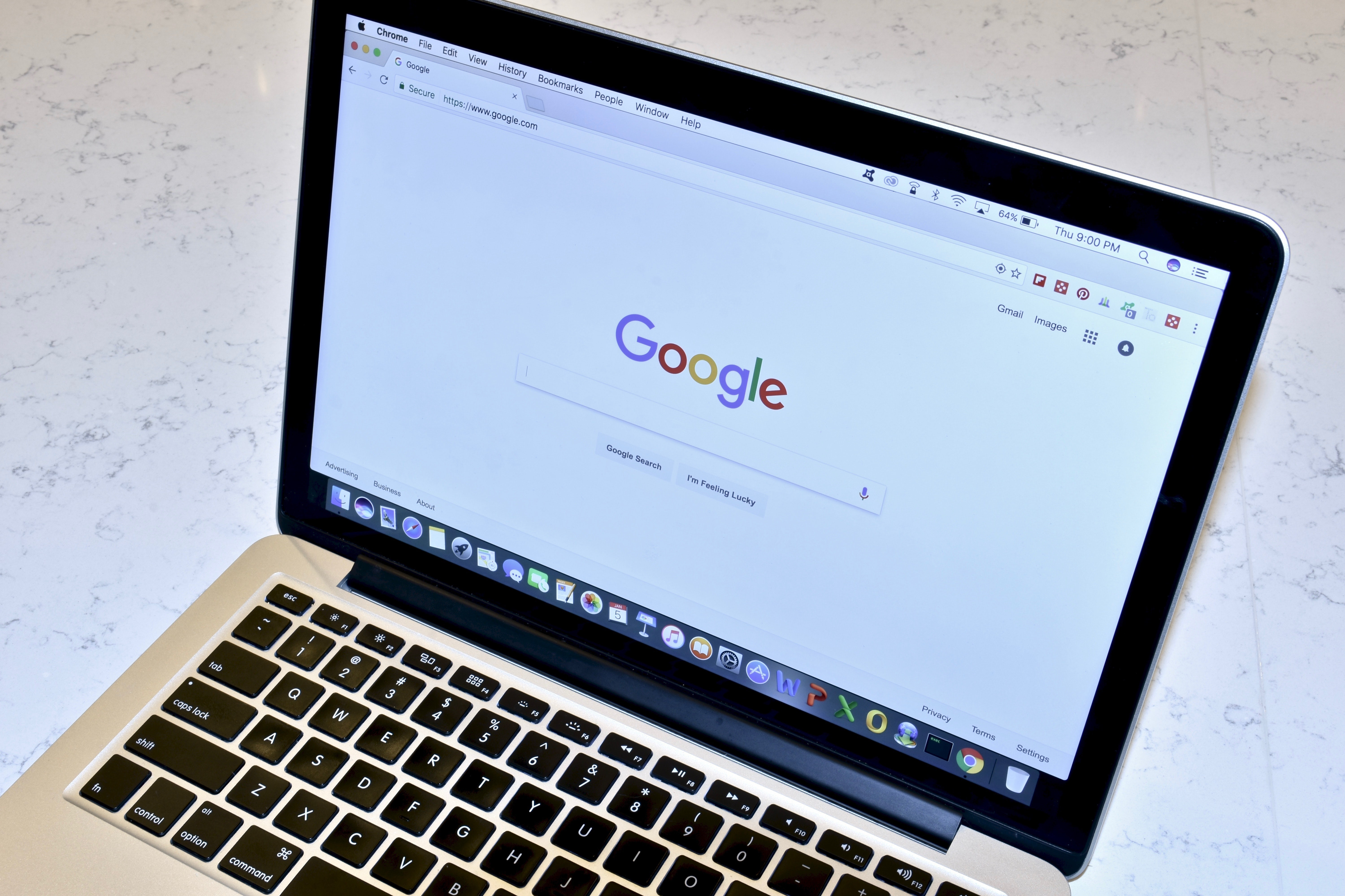 A laptop displays Google's search page | Source: Shutterstock