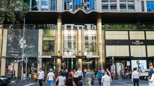 Pedestrians outside St Collins Lane, a fashion and dining destination mall in Melbourne | Source: Shutterstock