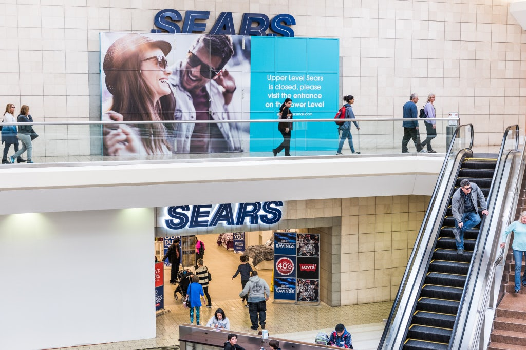 A Sears store displays its closure sign