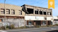 Deserted commercial buildings along one of Detroit's major streets | Source: Shutterstock