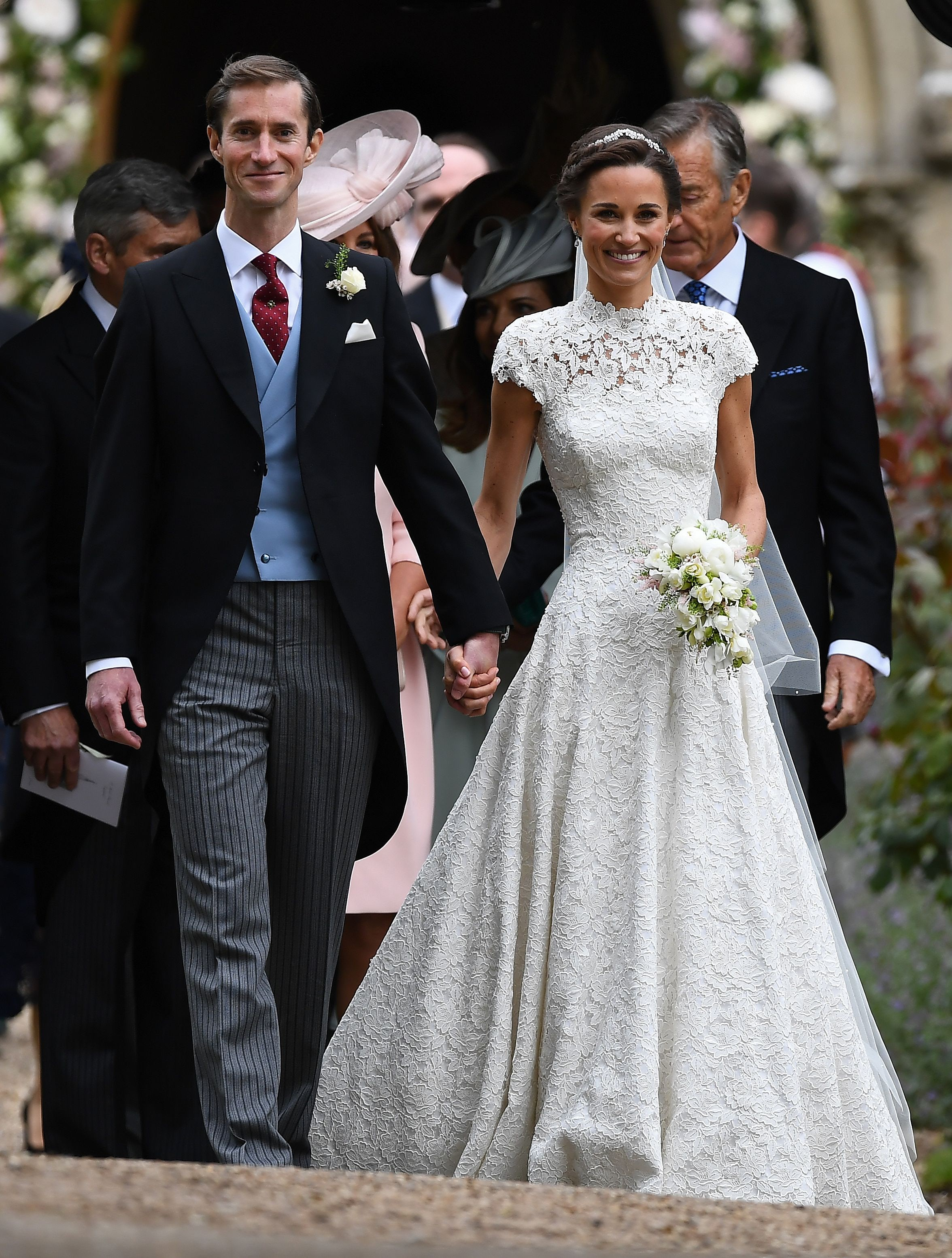 Pippa Middleton with her new husband James Matthews in her Giles Deacon Couture wedding gown | Source: Getty Images