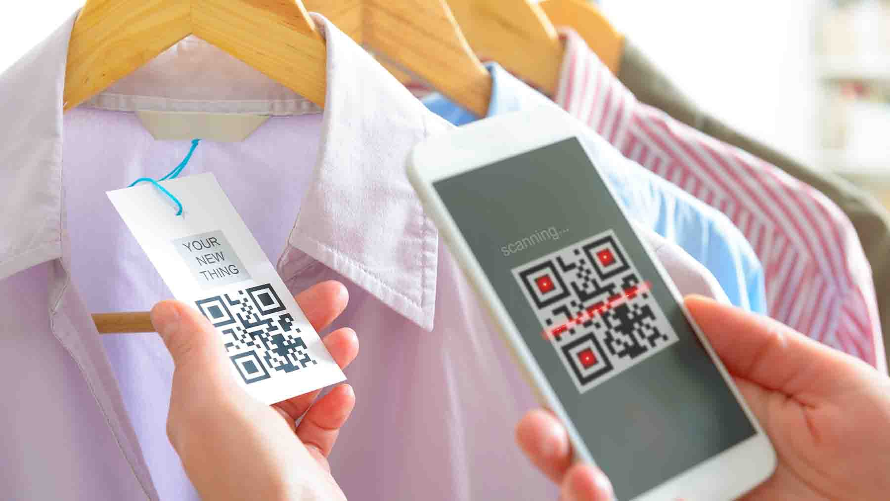 Shopper scanning a product's QR code | Source: Shutterstock