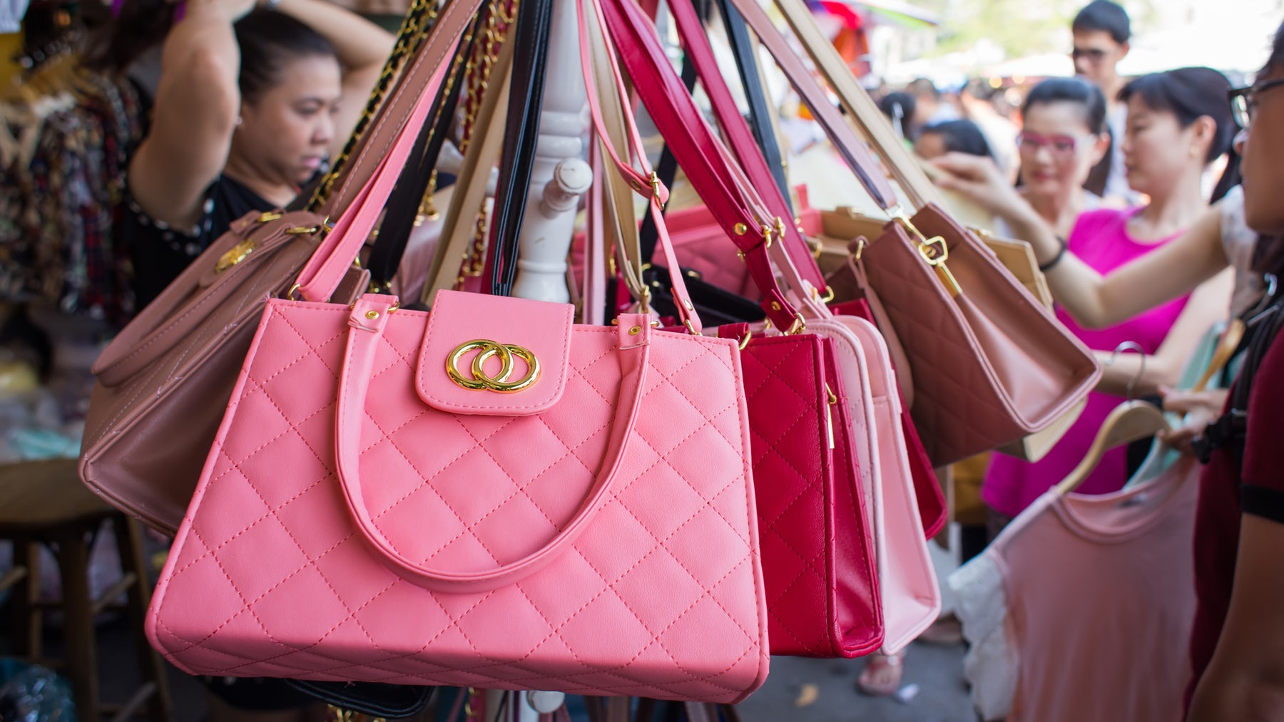 Counterfeit handbags on display in Bangkok, Thailand | Source: Shutterstock