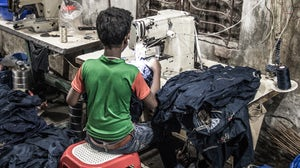 A child working in a garment factory in Dhaka, Bangladesh | Source: Shutterstock