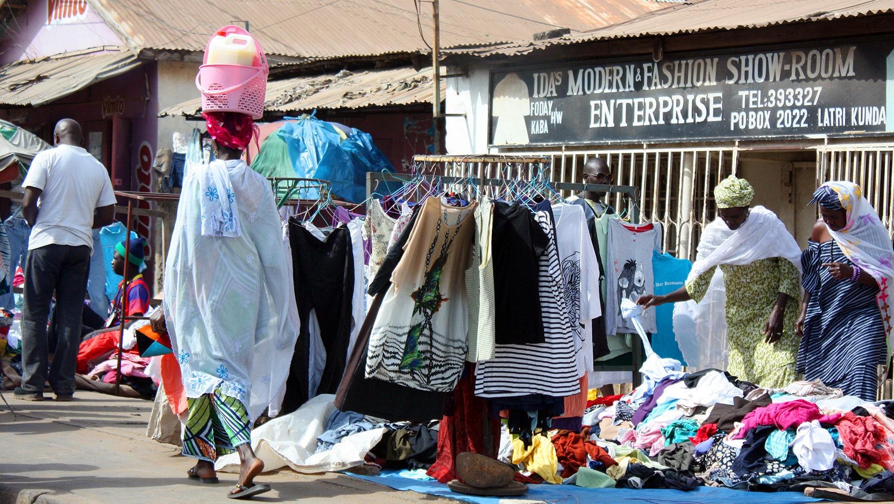 Shops at the Serrekunda market in Gambia, West Africa   Source: Shutterstock