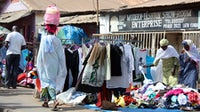 Shops at the Serrekunda market in Gambia, West Africa | Source: Shutterstock