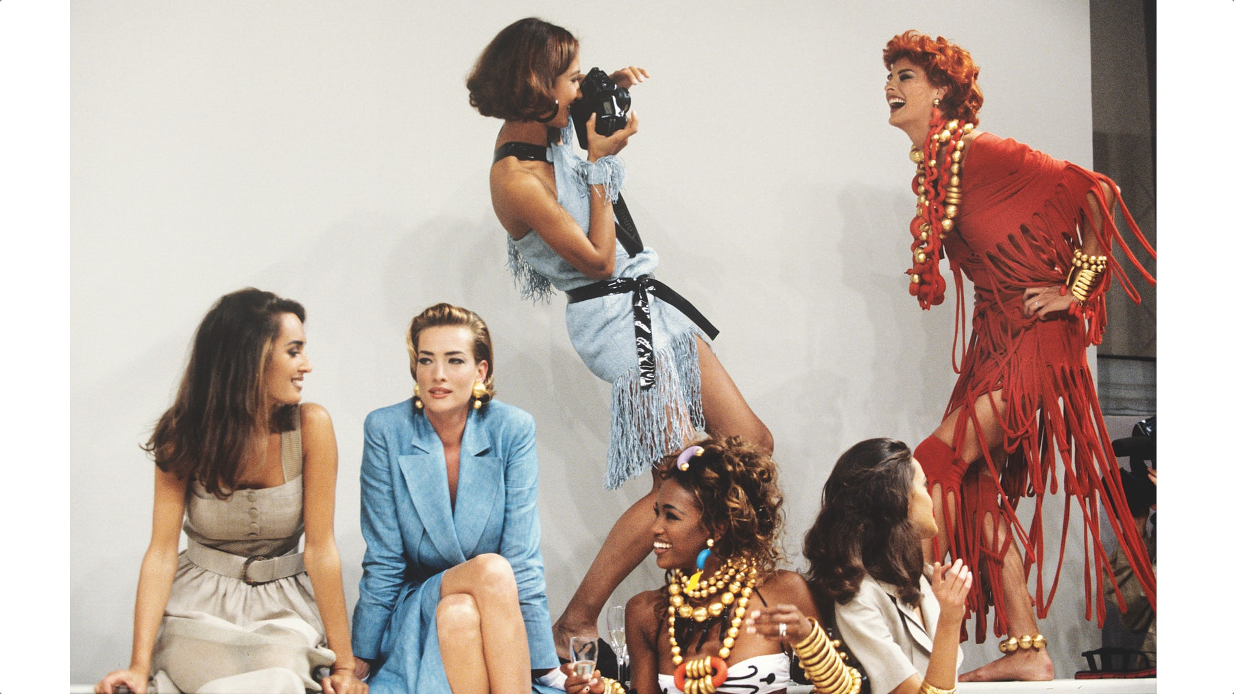 The supermodels of the day, captured backstage at the S/S'92 Fendi show by Chris Moore | Source: Catwalking.com