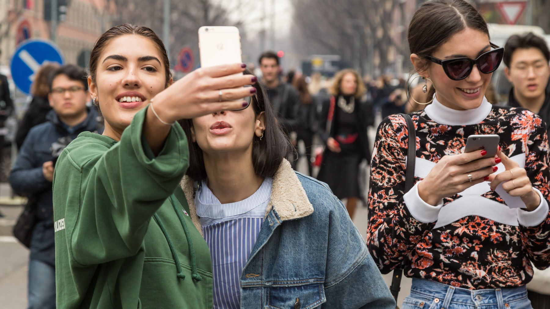 People taking selfies in Milan | Source: Shutterstock