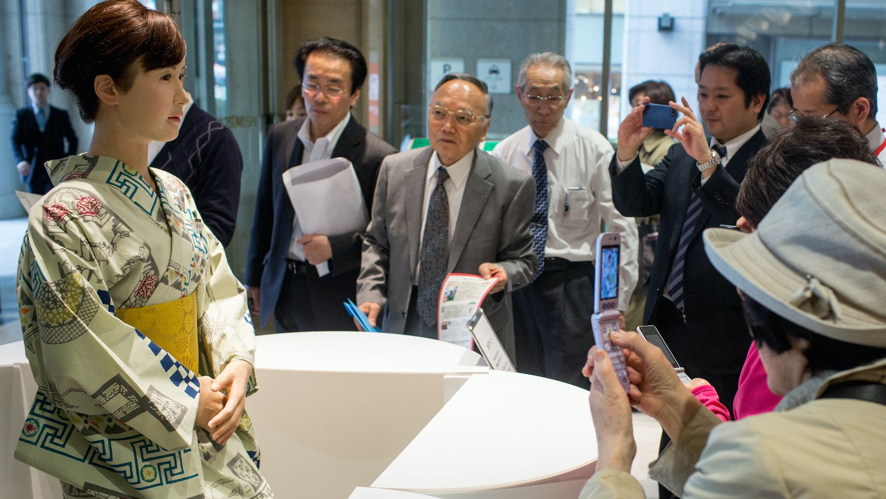 """Shoppers take photos of humanoid robot """"Aiko Chihira"""" at the Mitsukoshi department store   Source: Getty Images"""