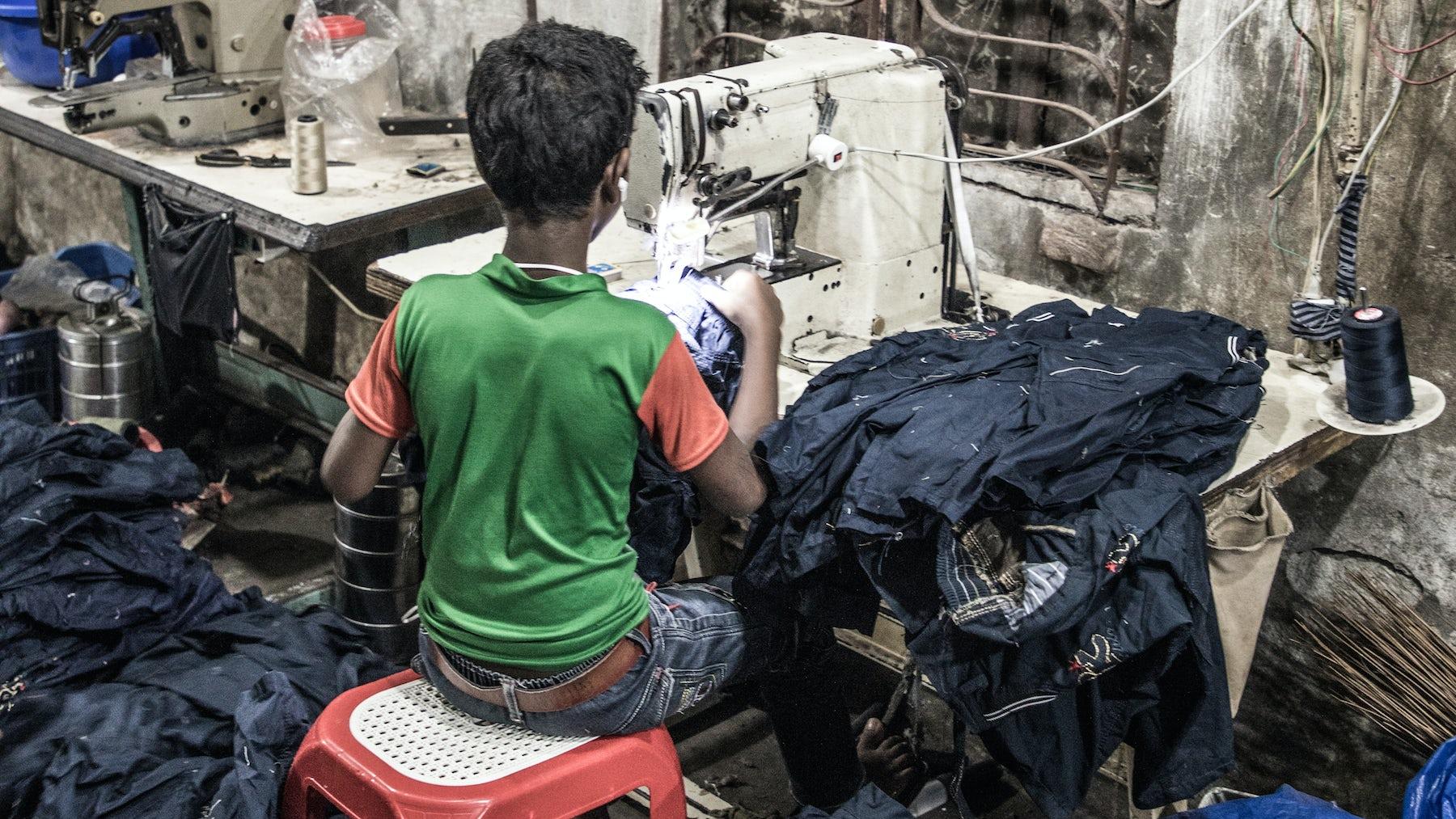 A child garment worker | Source: Shutterstock